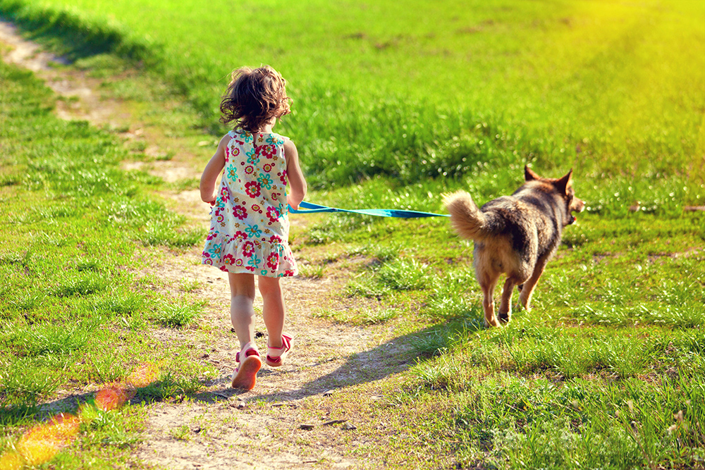 Girl running with her dog.