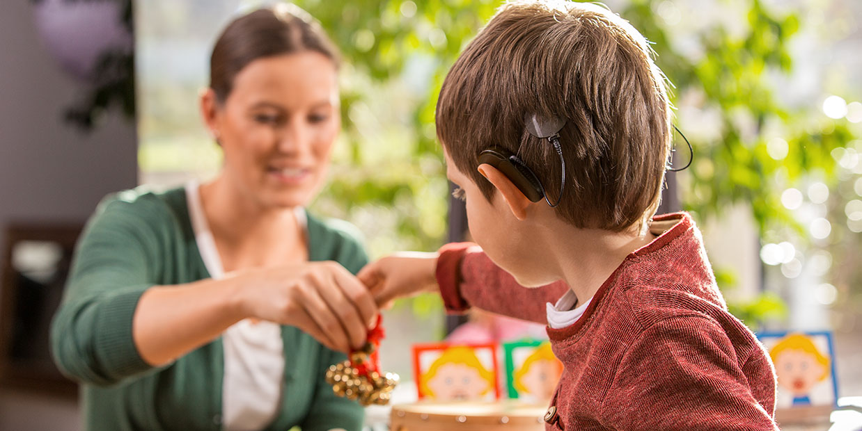5 Ways Barrier Games Can Help Your Child With A Cochlear Implant   The MED-EL Blog
