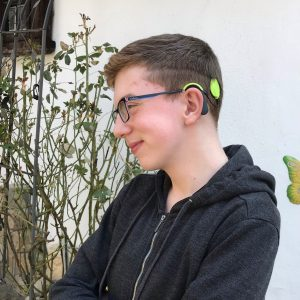boy with cochlear implant audio processor on one side